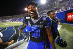 Memphis wide receiver Damonte Coxie celebrates with his teammates after their 35-23 win over Navy in an NCAA college football game Thursday, Sept. 26, 2019, in Memphis, Tenn. (Joe Rondone/The Commercial Appeal via AP)