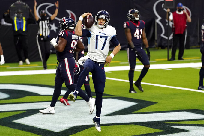 Tennessee Titans quarterback Ryan Tannehill (17) celebrates after running for a touchdown against the Houston Texans during the second half of an NFL football game Sunday, Jan. 3, 2021, in Houston. (AP Photo/Sam Craft)