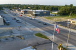 In this July 24, 2019, photo, cars move along West Florissant Avenue, the scene of nightly protests in the weeks following the shooting death of Michael Brown by a police officer in 2014, in Ferguson, Mo. The road is much quieter today. (AP Photo/Jeff Roberson)
