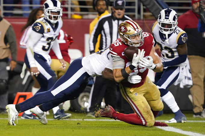 San Francisco 49ers tight end George Kittle (85) scores as Los Angeles Rams inside linebacker Cory Littleton defends during the second half of an NFL football game in Santa Clara, Calif., Saturday, Dec. 21, 2019. (AP Photo/Tony Avelar)