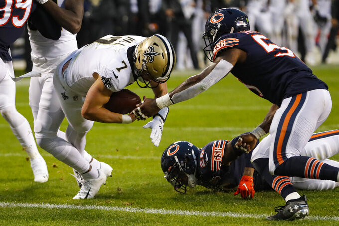 New Orleans Saints quarterback Taysom Hill (7) dives in for a touchdown in front of Chicago Bears inside linebacker Danny Trevathan (59) during the second half of an NFL football game in Chicago, Sunday, Oct. 20, 2019. (AP Photo/Charles Rex Arbogast)