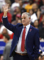 San Diego State coach Brian Dutcher gestures during the first half of the team's NCAA college basketball game against Boise State in the Mountain West Conference men's tournament Friday, March 6, 2020, in Las Vegas. (AP Photo/Isaac Brekken)
