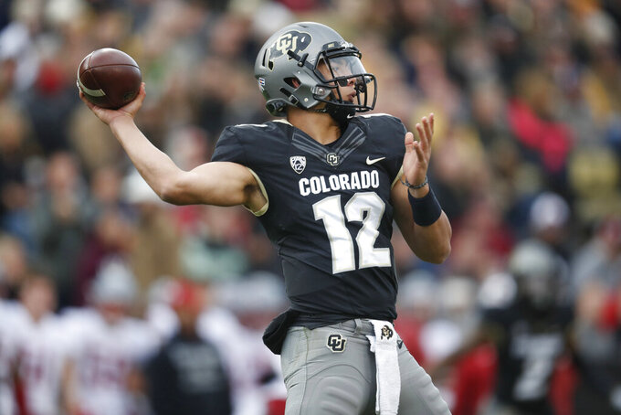 FILE - In this Saturday, Nov. 17, 2018, file photo, Colorado quarterback Steven Montez looks to throw a pass against Washington State in the second half of an NCAA college football game in Boulder, Colo. Montez will lead Colorado into its first game of the new NCAA season against Colorado State Friday night in Denver. (AP Photo/David Zalubowski, File)