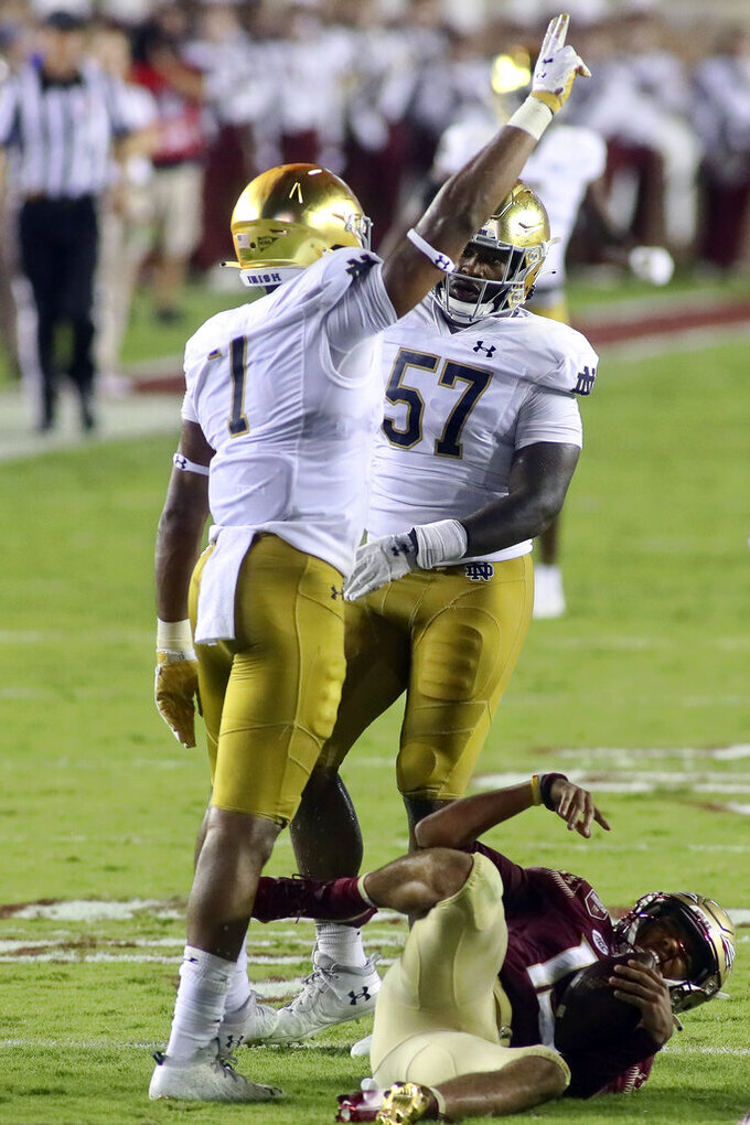 Notre Dame defensive lineman Isaiah Foskey (7) celebrates after sacking Florida State quarterback Jordan Travis (13) in the second quarter of an NCAA college football game Sunday, Sept. 5, 2021, in Tallahassee, Fla. (AP Photo/Phil Sears)