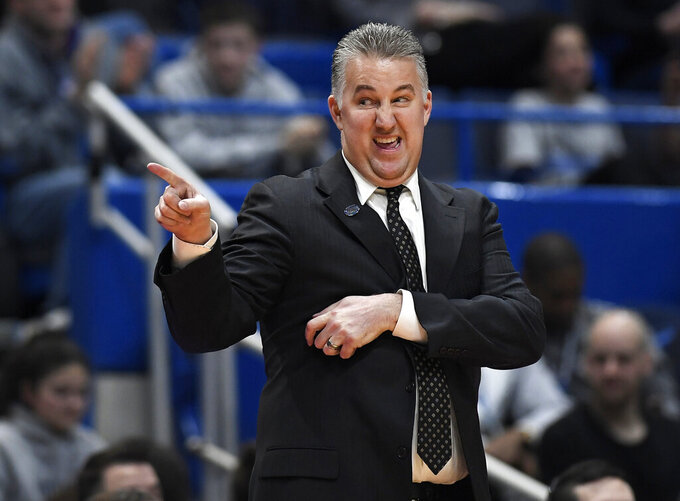 Purdue head coach Matt Painter gestures during the second half of a second round men's college basketball game against Villanova in the NCAA tournament, Saturday, March 23, 2019, in Hartford, Conn. (AP Photo/Jessica Hill)