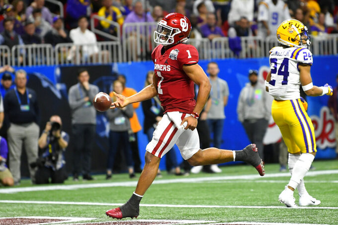 Oklahoma quarterback Jalen Hurts (1) runs into the end zone for a touchdown against LSU during the first half of the Peach Bowl NCAA semifinal college football playoff game, Saturday, Dec. 28, 2019, in Atlanta. (AP Photo/John Amis)