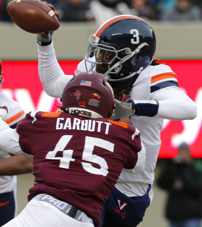 Virginia linebacker Reed Kellam, (45), grabs the hair of Virginia quarterback Bryce Perkins (3) as he sacks him during the first half of an NCAA college football game in Blacksburg, Va., Friday, Nov. 23, 2018. (AP Photo/Steve Helber)