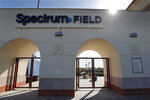 Gates to Spectrum Field, spring training baseball game home of the Philadelphia Phillies are locked, Friday, March 13, 2020, in Clearwater, Fla. Major League Baseball has delayed the start of its season by at least two weeks because of the coronavirus outbreak and suspended the rest of its spring training schedule. (AP Photo/Carlos Osorio)