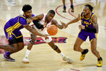 Arkansas guard Davonte Davis (4), LSU forward Mwani Wilkinson (0), and LSU guard Ja'Vonte Smart (1) fight for a loose ball during the second half of an NCAA college basketball game in Fayetteville, Ark. Saturday, Feb. 27, 2021. (AP Photo/Michael Woods)