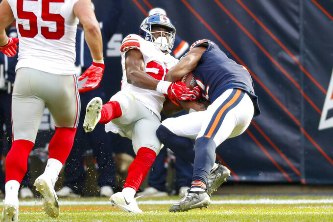 New York Giants defensive back Corey Ballentine (25) tries to strip the ball from Chicago Bears wide receiver Allen Robinson (12) on his way to a Bear's touchdown during the second half of an NFL football game in Chicago, Sunday, Nov. 24, 2019. (AP Photo/Paul Sancya)