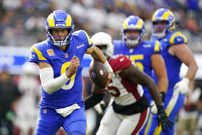 Los Angeles Rams quarterback Matthew Stafford rolls out during the second half in an NFL football game against the Arizona Cardinals Sunday, Oct. 3, 2021, in Inglewood, Calif. (AP Photo/Ashley Landis)