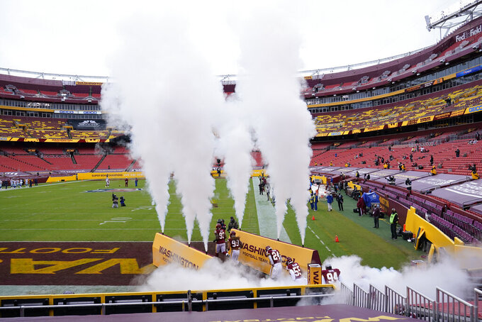 Members of the Washington Football Team take the field before the start of the first half of an NFL football game against Dallas Cowboys, Sunday, Oct. 25, 2020, in Landover, Md. (AP Photo/Susan Walsh)