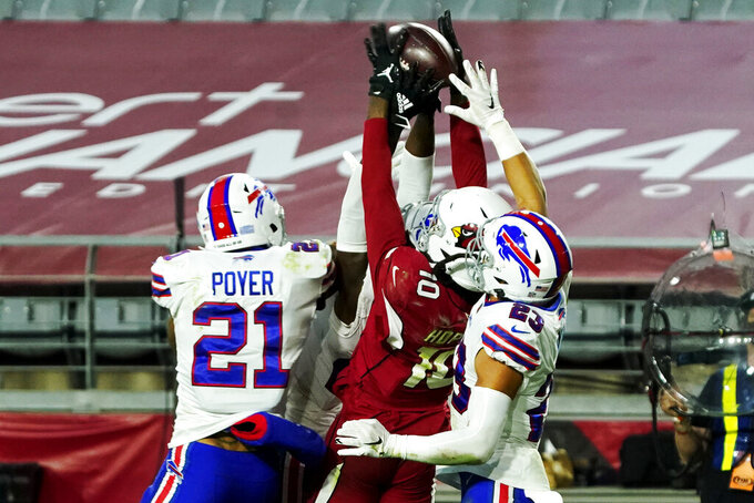 Arizona Cardinals wide receiver DeAndre Hopkins (10) pulls in the game winning touchdown pass as Buffalo Bills free safety Jordan Poyer (21) and strong safety Micah Hyde (23) defend during the second half of an NFL football game, Sunday, Nov. 15, 2020, in Glendale, Ariz. The Cardinals won 32-20. (AP Photo/Rick Scuteri)