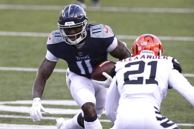 Tennessee Titans' A.J. Brown (11) makes a touchdown reception against Cincinnati Bengals' Mackensie Alexander (21) during the second half of an NFL football game, Sunday, Nov. 1, 2020, in Cincinnati. (AP Photo/Jay LaPrete)