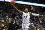 Seton Hall guard Myles Powell (13) drives to the basket past Georgetown guard Jonathan Mulmore (2) during the second half of an NCAA college basketball game, on Saturday, Jan. 13, 2018, in Newark, N.J. Seton Hall won 74-61. (AP Photo/Adam Hunger)