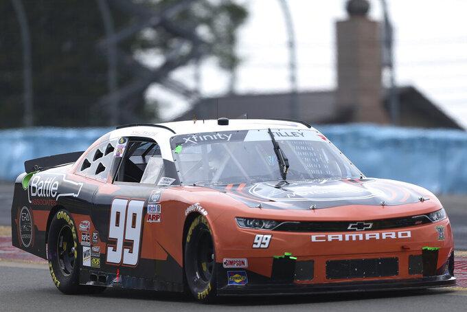 Kyle Tilley drivers between Turn 1 and the Esses in the NASCAR Xfinity Series auto race at Watkins Glen International in Watkins Glen, N.Y., on Saturday, Aug. 7, 2021. (AP Photo/Joshua Bessex)