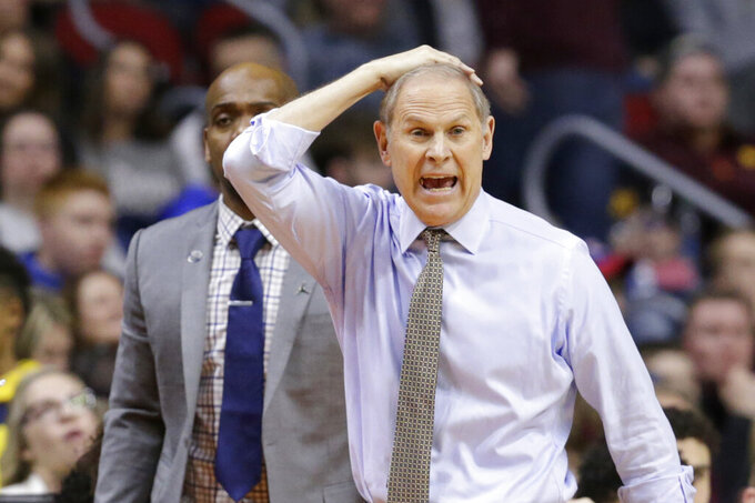 Michigan coach John Beilein calls a play during the first half of a second round men's college basketball game against Florida in the NCAA Tournament, in Des Moines, Iowa, Saturday, March 23, 2019. (AP Photo/Nati Harnik)