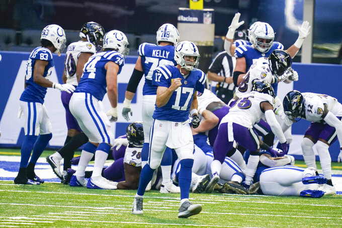 Indianapolis Colts quarterback Philip Rivers (17) celebrates a touchdown against the Baltimore Ravens in the first half of an NFL football game in Indianapolis, Sunday, Nov. 8, 2020. (AP Photo/Darron Cummings)