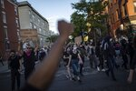 Protesters march down the street during a solidarity rally for George Floyd, Sunday, May 31, 2020, in the Brooklyn borough of New York. Protests were held throughout the city over the death of Floyd, a black man in police custody in Minneapolis who died after being restrained by police officers on Memorial Day. (AP Photo/Wong Maye-E)