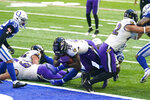 Baltimore Ravens running back Gus Edwards (35) dives in for a touchdown against the Indianapolis Colts in the second half of an NFL football game in Indianapolis, Sunday, Nov. 8, 2020. (AP Photo/Darron Cummings)