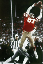 "FILE - In this Jan. 10, 1982, file photo, San Francisco 49ers wide receiver Dwight Clark makes ""The Catch,"" on a pass from Joe Montana that tied the game late in the fourth quarter against the Dallas Cowboys in the NFC championship football game at Candlestick Park in San Francisco. With ""The Catch"" that sent San Francisco to its first Super Bowl and ""The Blown Call"" that kept New Orleans at home, NFC championship games have two seminal moments that rank with just about any in postseason history. (Phil Huber/The Dallas Morning News via AP, File)"