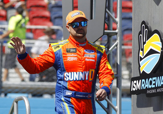 Ricky Stenhouse Jr. waves to the crowd during driver introductions prior to the start of the NASCAR Cup Series auto race at ISM Raceway, Sunday, March 10, 2019, in Avondale, Ariz. (AP Photo/Ralph Freso)