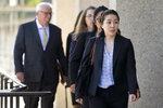 Tiffany Li, foreground, arrives at the courthouse Thursday, Sept. 12, 2019, in Redwood City, Calif. The trial of Li, a Chinese real estate scion who posted a $35 million bail after being charged with orchestrating the 2016 murder of her children's father, is set to start Thursday.(AP Photo/Tony Avelar)