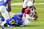 Arizona Cardinals quarterback Kyler Murray is sacked by Los Angeles Rams defensive end Morgan Fox (97) during the first half of an NFL football game Sunday, Jan. 3, 2021, in Inglewood, Calif. (AP Photo/Jae C. Hong)