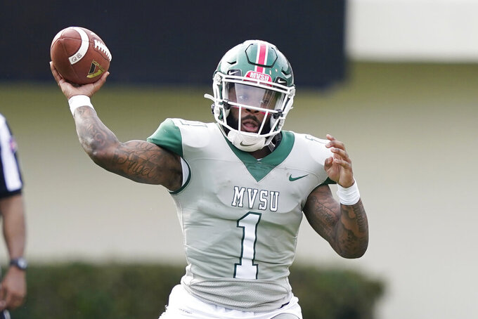 Mississippi Valley State quarterback Jalani Eason (1) passes against Jackson State during the second half of an NCAA college football game, Sunday, March 14, 2021, in Jackson, Miss. (AP Photo/Rogelio V. Solis)