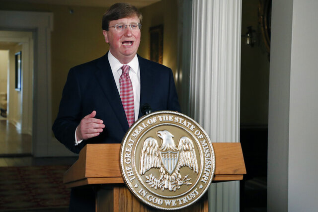 FILE - In this June 30, 2020 file photo, Mississippi Gov. Tate Reeves delivers a televised address prior to signing a bill retiring the last state flag in the United States with the Confederate battle emblem, during a ceremony at the Governor's Mansion in Jackson, Miss. Reeves tweeted Tuesday, July 7 that he has tested negative for the coronavirus, a day after announcing he was going into isolation after being in contact with a lawmaker who tested positive.   (AP Photo/Rogelio V. Solis, Pool, File)