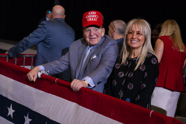 FILE - In this Feb. 21, 2020, file photo businessman and Republican donor Sheldon Adelson waits for the arrival of President Donald Trump to a campaign rally at the Las Vegas Convention Center in Las Vegas. Adelson and his wife have given $75 million to a new super PAC that is attacking Democratic nominee Joe Biden, an investment made amid GOP concern that President Donald Trump's campaign is flailing and might not be able to correct course. (AP Photo/Evan Vucci, File)