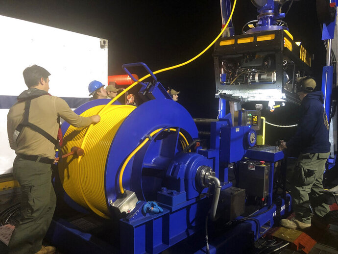 In this photo provided by the U.S. Navy, Undersea Rescue Command deploys the Sibitzky Remotely Operated Vehicle (ROV) from the deck of the Military Sealift Command-chartered merchant vessel HOS Dominator off the coast of Southern California on Sunday, Aug. 2, 2020. Officials with the 15th Marine Expeditionary Unit (MEU), I Marine Expeditionary Force (MEF), and the Makin Island Amphibious Ready Group (ARG) positively identified on Aug. 3, 2020 the location of the amphibious assault vehicle that sunk off the coast of San Clemente Island on July 30,2020. The U.S. Navy's Undersea Rescue Command confirmed that human remains have also been identified using their underwater remotely-operated video systems from the merchant vessel. (Lt. Curtis Khol/U.S. Navy via AP)