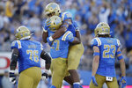 UCLA running back Joshua Kelley (27) celebrates his rushing touchdown with teammate Mike Martinez (88) during the first half of an NCAA college football game against Arizona State Saturday, Oct. 26, 2019, in Pasadena, Calif. (AP Photo/Marcio Jose Sanchez)