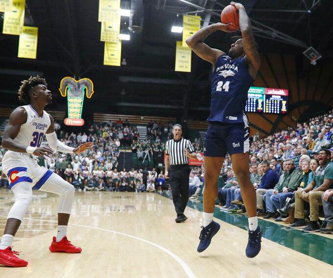 Nevada forward Jordan Caroline, right, shoots a 3-pointer over Colorado State guard Kris Martin during the first half of an NCAA college basketball game Wednesday, Feb. 6, 2019, in Fort Collins, Colo. (AP Photo/David Zalubowski)