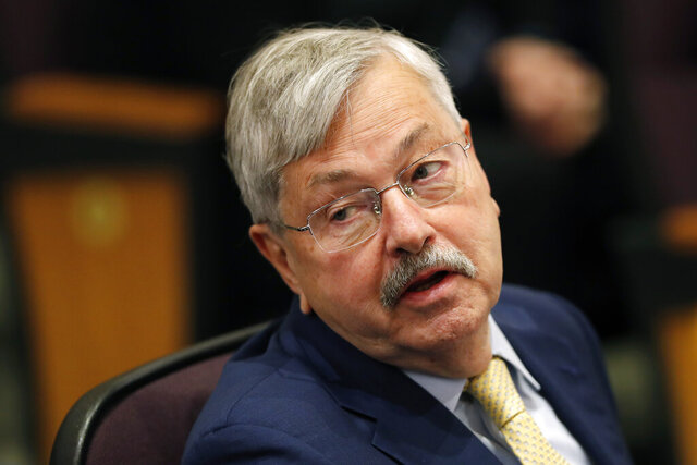 FILE - In this March 4, 2019 file photo, U.S. Ambassador to China Terry Branstad listens to Secretary of State Mike Pompeo speak at an event in Johnston, Iowa. The U.S. ambassador to China said Wednesday, April 15, 2020, that he doesn't believe Beijing is deliberately blocking exports of personal protective equipment and medical supplies, adding that the shipment of 1,200 tons of such products to the U.S. could not have been possible without Chinese support. (AP Photo/Charlie Neibergall, File)
