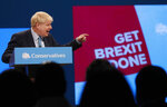 Britain's Prime Minister Boris Johnson delivers his Leader's speech at the Conservative Party Conference in Manchester, England, Wednesday, Oct. 2, 2019. Britain's ruling Conservative Party is holding their annual party conference. (AP Photo/Frank Augstein)