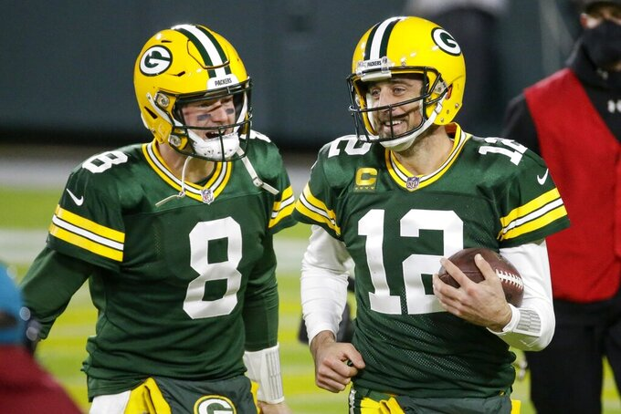 Green Bay Packers' Aaron Rodgers celebrates a touchdown pass with Tim Boyle (8) during the second half of an NFL football game against the Philadelphia Eagles Sunday, Dec. 6, 2020, in Green Bay, Wis. The pass was Rodgers' 400th career touchdown pass. (AP Photo/Mike Roemer)