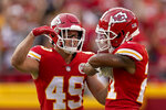 Kansas City Chiefs cornerback Mike Hughes, right, celebrates with defensive back Daniel Sorensen (49) after intercepting a pass intended for Cleveland Browns tight end Harrison Bryant during the second half of an NFL football game Sunday, Sept. 12, 2021, in Kansas City, Mo. (AP Photo/Charlie Riedel)