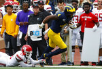 Michigan wide receiver Nico Collins (4) breaks the tackle of Rutgers defensive back Damon Hayes (22) for a 48-yard touchdown reception in the first half of an NCAA college football game in Ann Arbor, Mich., Saturday, Sept. 28, 2019. (AP Photo/Paul Sancya)