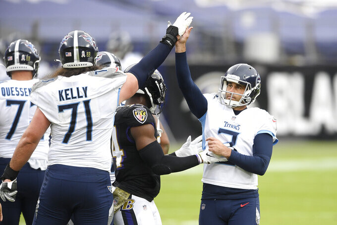 Tennessee Titans kicker Stephen Gostkowski, right, celebrates after kicking a field goal against the Baltimore Ravens during the first half of an NFL football game, Sunday, Nov. 22, 2020, in Baltimore. (AP Photo/Nick Wass)