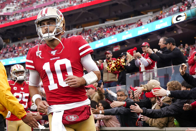 San Francisco 49ers quarterback Jimmy Garoppolo (10) runs onto the field before the NFL NFC Championship football game against the San Francisco 49ers Sunday, Jan. 19, 2020, in Santa Clara, Calif. (AP Photo/Tony Avelar)