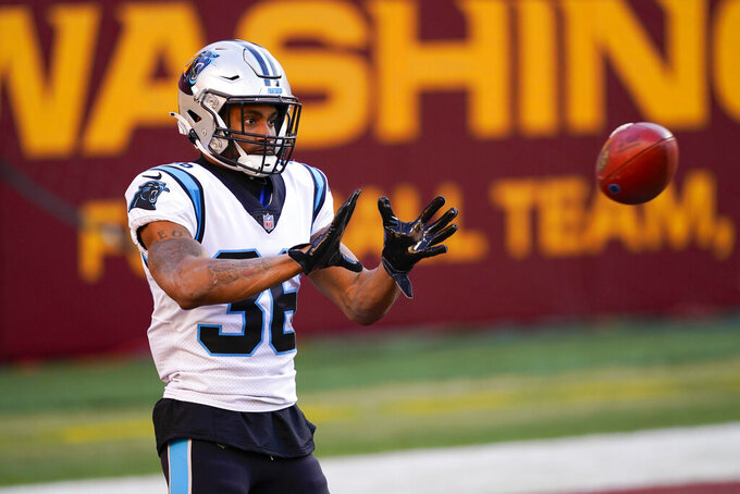 Carolina Panthers running back Trenton Cannon (36) catches the ball before the start of an NFL football game against the Washington Football Team, Sunday, Dec. 27, 2020, in Landover, Md. (AP Photo/Mark Tenally)