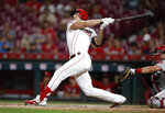 Cincinnati Reds' Michael Lorenzen follows through on a two-run home run off Philadelphia Phillies relief pitcher Blake Parker during the eighth inning of a baseball game Wednesday, Sept. 4, 2019, in Cincinnati. (AP Photo/Gary Landers)