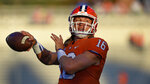 FILE - In this Sept. 21, 2019, file photo, Clemson quarterback Trevor Lawrence throws the ball during an NCAA college football game, in Clemson, S.C. Lawrence was selected to The Associated Press All-Atlantic Coast Conference football team, Tuesday, Dec. 10, 2019.(AP Photo/Richard Shiro, File)