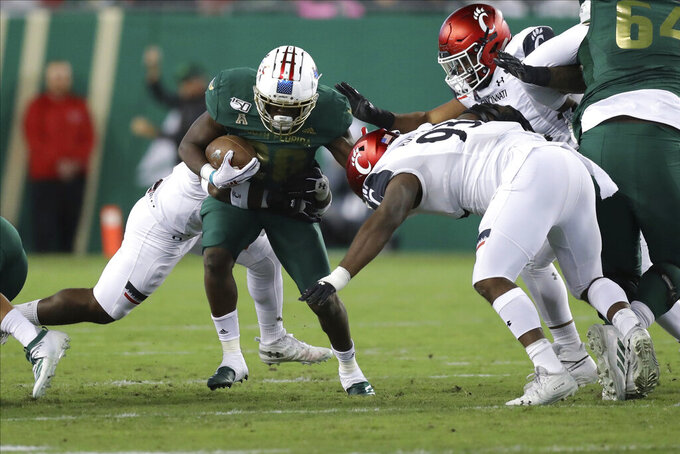 No. 17 Cincinnati rallies to beat South Florida 20-17