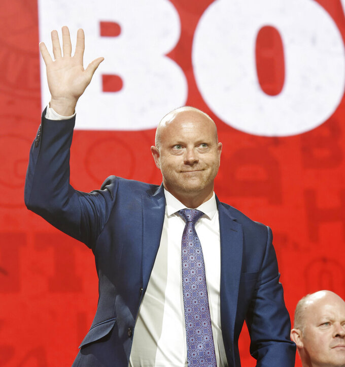 FILE - Chicago Blackhawks general manager Stan Bowman is introduced during the Chicago Blackhawks Convention in Chicago, in this Friday, July 26, 2019, file photo. USA Hockey announced Wednesday, March 31, 2021, that Bowman will be the general manager of the 2022 U.S. Olympic Men's ice hockey team. (John Starks/Daily Herald via AP, File)