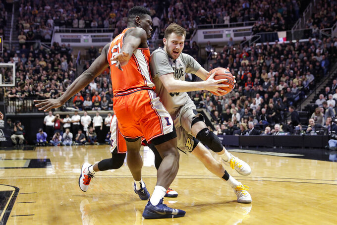 Purdue guard Sasha Stefanovic (55) drives on Illinois center Kofi Cockburn (21) during the second half of an NCAA college basketball game in West Lafayette, Ind., Tuesday, Jan. 21, 2020. Illinois defeated Purdue 79-62. (AP Photo/Michael Conroy)