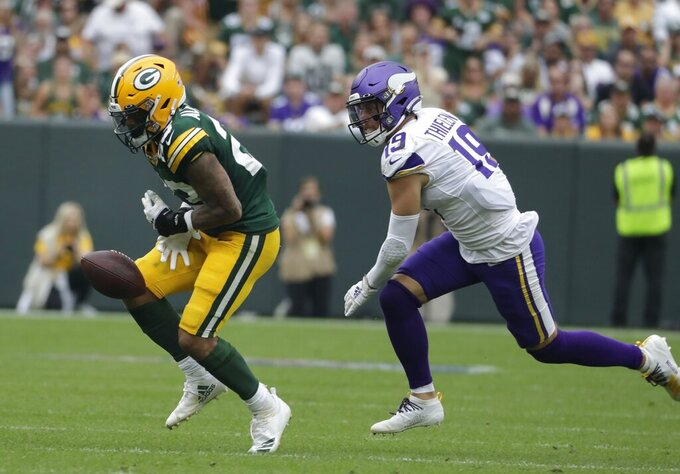 Green Bay Packers' Jaire Alexander can't intercept a pass intended for Minnesota Vikings' Adam Thielen during the second half of an NFL football game Sunday, Sept. 15, 2019, in Green Bay, Wis. (AP Photo/Morry Gash)
