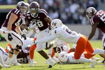 Texas A&M running back Isaiah Spiller (28) brushes off a tackle by UTSA safety SaVion Harris (6) for a first down run during the first quarter of an NCAA college football game, Saturday, Nov. 2, 2019, in College Station, Texas. (AP Photo/Sam Craft)