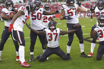Houston Texans strong safety Jahleel Addae (37) celebrates with teammates after he intercepted a pass by Tampa Bay Buccaneers quarterback Jameis Winston during the second half of an NFL football game Saturday, Dec. 21, 2019, in Tampa, Fla. (AP Photo/Jason Behnken)